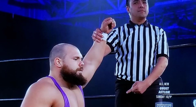 Professional Wrestling Referee Dan Tanaka Raising Michael Elgins Arm